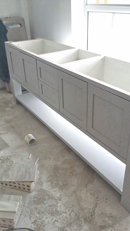 Guest ensuite cabinet in Dulux flooded gum half strength