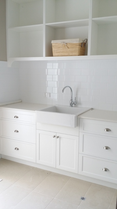 laundry tiling and cabinets