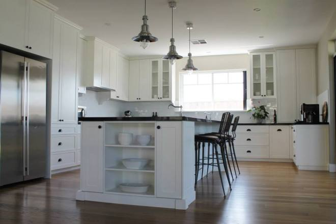 Kitchen with shaker style cabinets. Pendant lights from Ikea.